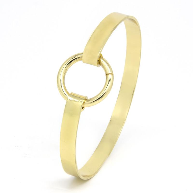 gold-tone bangle-with-a-circular-design